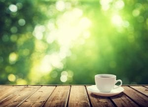 bigstock-cup-coffee-and-sunny-trees-bac-69264313