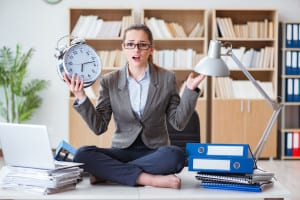 76179458 - businesswoman with alarm clock in office