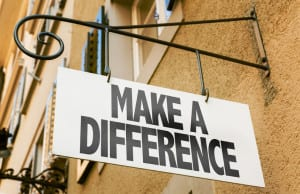 63388629 - make a difference signpost on building background